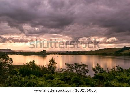 Bright sun beams lake Rotorua, North Island - New Zealand - stock photo