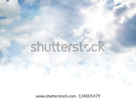 Bright sun in clouds. Copy space - stock photo