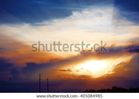 Bright sun in the blue sky with clouds. Brightly sunlight. Sunny day. Concept if freedom. - stock photo