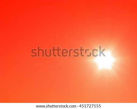 Bright sun on red-orange sky, dawns and sunsets - stock photo