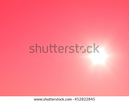 Bright sun on red sky, from sunbeams gradient effect of red color - stock photo