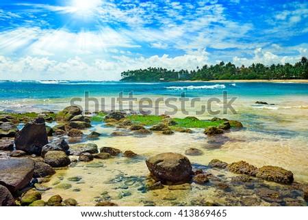 Bright sun on tropical sea - stock photo