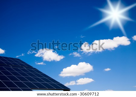 Bright sun over a photovoltaic panel. - stock photo