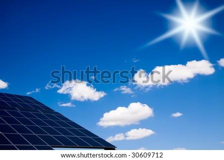 Bright sun over a photovoltaic panel. - stock photo