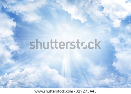 Bright sun shining in clouds - stock photo
