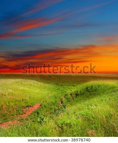 Bright sunset over rural landscape - stock photo