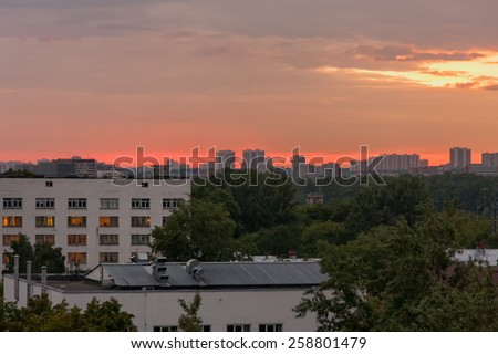 Bright sunset with dramatic cloudscape over skyline