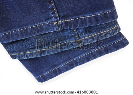 Bright thread seams on blue denim trousers on a white background - stock photo