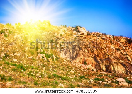 Bright Tropical mountainous landscape - single mountain in India at sunset. Sun-filled warm Golden landscape (Magic mountain treasure)