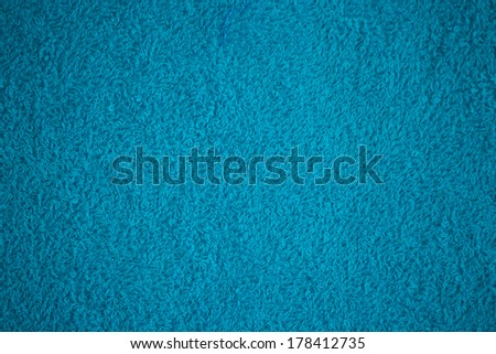 bright turquoise bath towel surface texture - stock photo