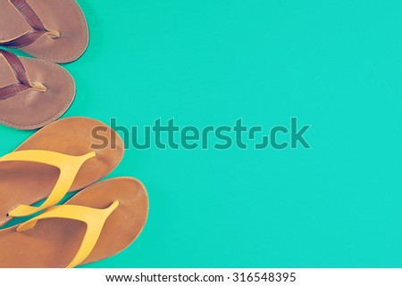 Bright two flip flops on mint green background with copy-space. Summer colors style. Minimalism. Concept of vacation, travel, summer, shopping. - stock photo