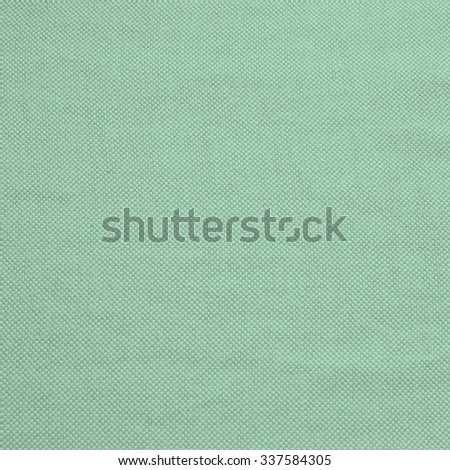 bright vintage green fern colored of burlap cotton fabrics background pattern:textile edge linen clothing pattern wallpaper backdrop texture.picture in square backdrop. - stock photo