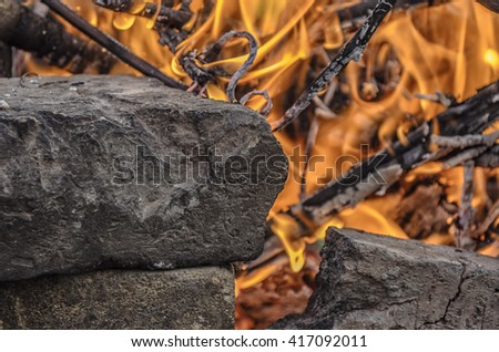 Bright warm fire and stones. It's always nice to get warm by the fire or by the fireplace. Create comfort with this texture in design to design posters, postcards, flyers, wall ...
