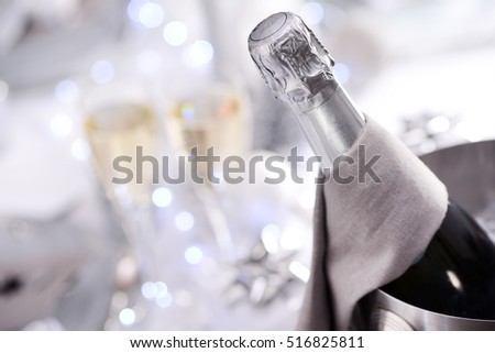 bright white and silver new year eve or christmas table in a luxury restaurant with champagne