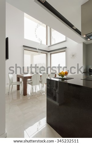 Bright white dining room in modern house - stock photo