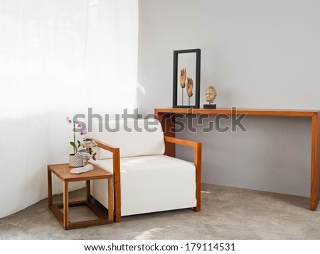 Bright white sofa seat in simple setting - stock photo