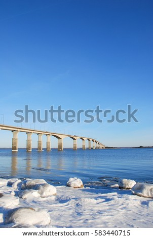 Bright winter day by the Oland Bridge in the Baltic Sea. The bridge is connecting the swedish island Oland with mainland Sweden