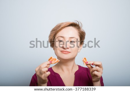 bright woman eating pancakes isolated studio