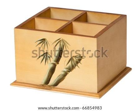 Bright wooden box with four cells for remote controls, on a seamless white background - stock photo