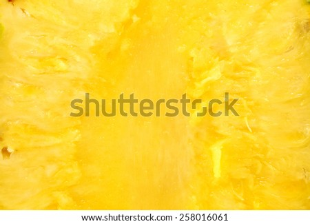 bright yellow background pineapple fruit pulp - stock photo
