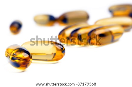 Bright yellow capsules with shallow focus - stock photo