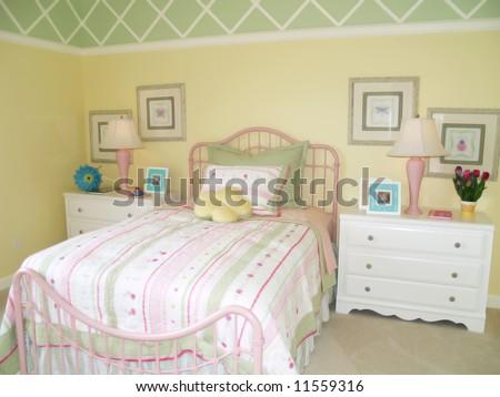 Bright yellow children's bedroom - stock photo