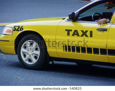 Bright yellow city taxicab waits for fare  with cabbie's arm out window.