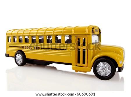 Bright yellow school bus arrives to transport children - stock photo