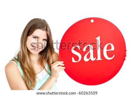 "Bright young woman holding a red panel where ""sale"" is written against a white background"