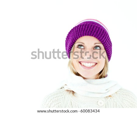 Bright young woman with cap in the winter smiling at the camera against a white background - stock photo