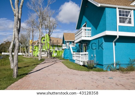 Brightly colored Abandon condominiums due to recession - stock photo