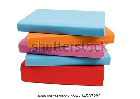Brightly colored books stacked unevenly/  Brightly Colored Books Isolated - stock photo