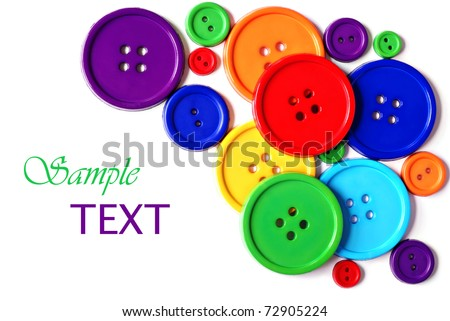 Brightly colored buttons on white background with copy space. - stock photo