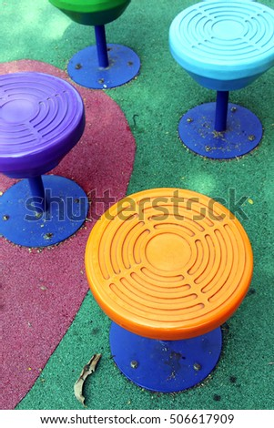 Brightly colored chairs Playground