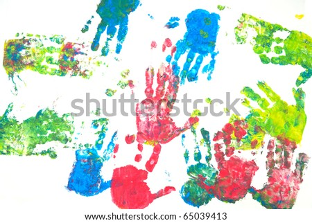 Brightly colored hands print on white background - stock photo