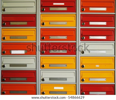 brightly colored letterboxes - stock photo