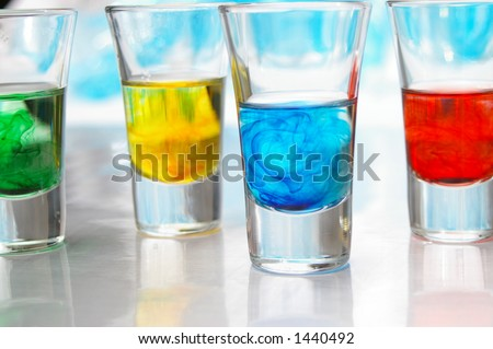Brightly colored liquids in glass vials. - stock photo