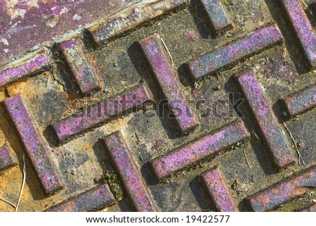 Brightly colored manhole cover. - stock photo