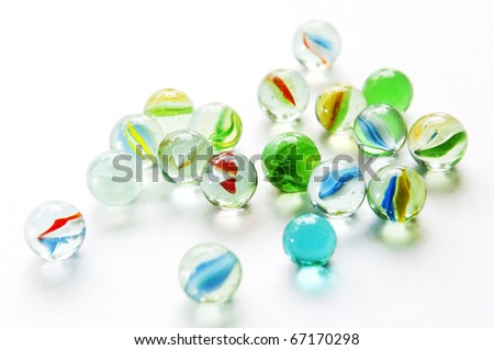 Brightly colored marbles in different shades on bright white - stock photo