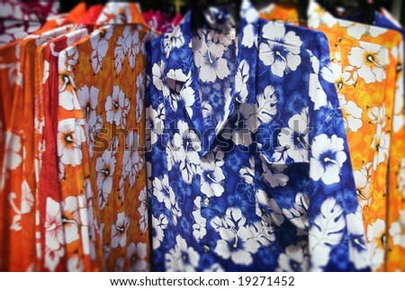Brightly colored Polynesian floral summer shirts - stock photo