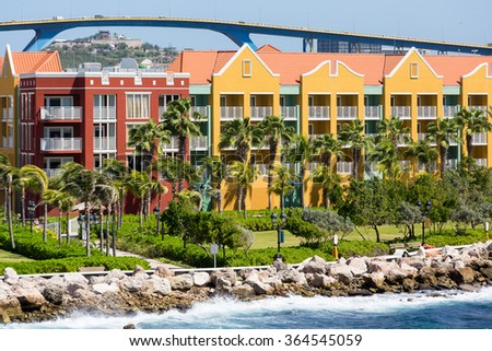 Brightly colored resort hotels on the coast of Curacao - stock photo