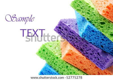 Brightly colored sponges on white background with copy space. - stock photo
