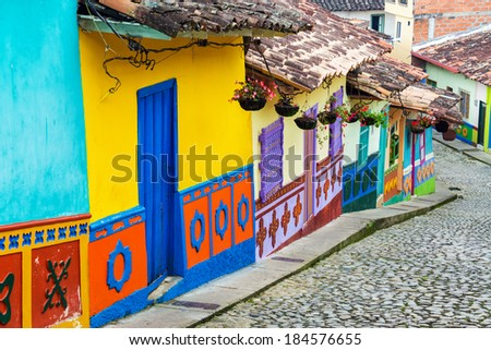 Brightly colored street in town of Guatape in Antioquia, Colombia - stock photo