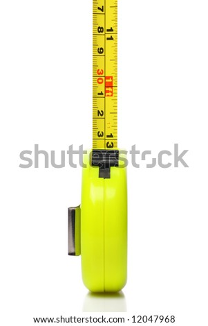 brightly colored tape measure, focus on front of yellow tool. - stock photo