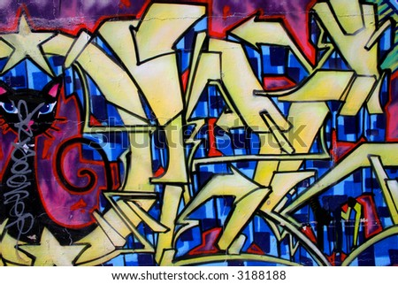 Brightly colored wall graffiti with an abstract type pattern. - stock photo