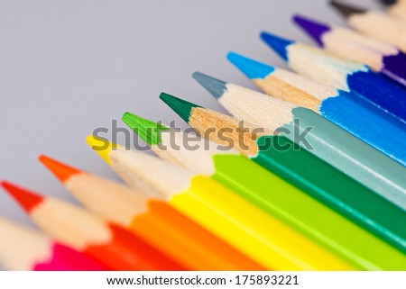 Brightly colored wooden pencils closeup shot background - stock photo