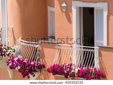 Brightly colorful and flowering plants on the balcony of villa in Positano, Italy