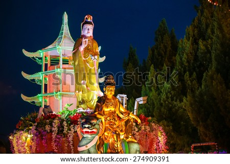 Brightly decorated buddha statue at a buddhish Temple during Wesak day at Kuala Lumpur Malaysia. - stock photo