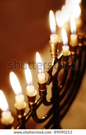 Brightly Glowing Hanukkah Menorah - Shallow Depth of Field - stock photo