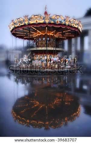 Brightly illuminated traditional carousel in Moscow. Russia - stock photo